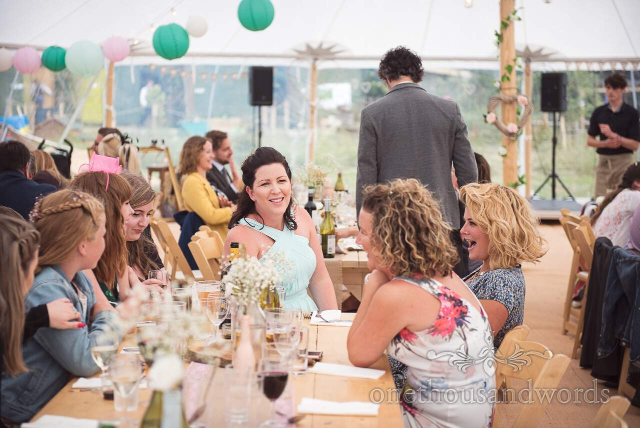 Purbeck Valley Farm Wedding Photographs of bridesmaid during marquee reception