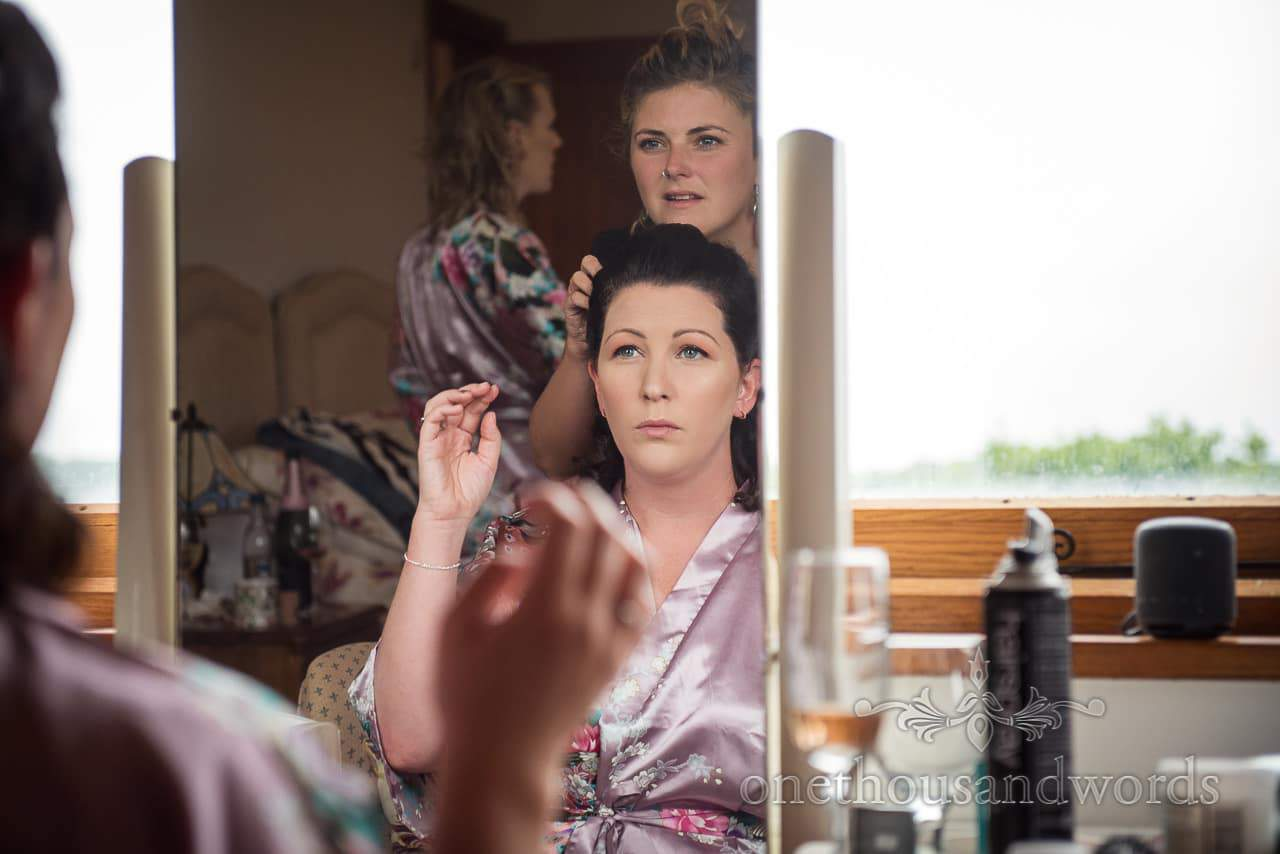 Purbeck Valley Farm Wedding Photographs of bridesmaid have hair styled