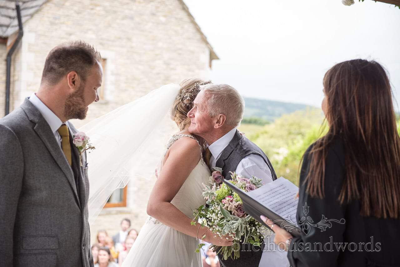 Purbeck Valley Farm Wedding Photographs of father giving daughter away