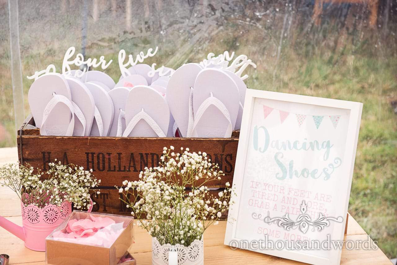 Purbeck Valley Farm Wedding Photographs of flip flops for tired feet