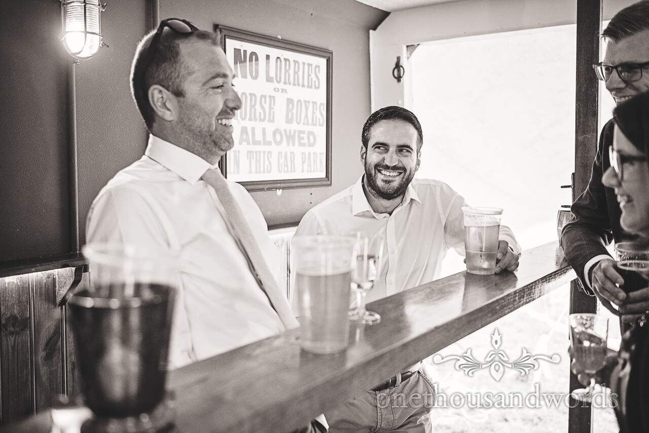Purbeck Valley Farm Wedding Photographs of guest enjoying drink in Boxpub