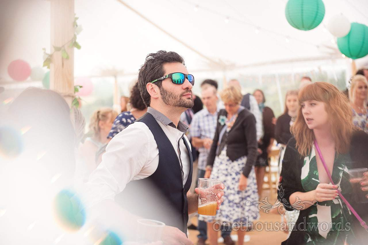 Purbeck Valley Farm Wedding Photographs of guest in sunglasses on the dance floor