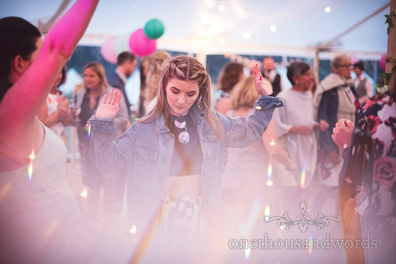 Purbeck Valley Farm Wedding Photographs of guests dancing at marquee reception