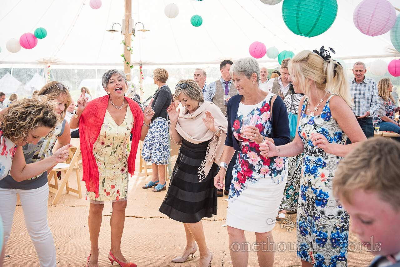Purbeck Valley Farm Wedding Photographs of guests dancing in marquee