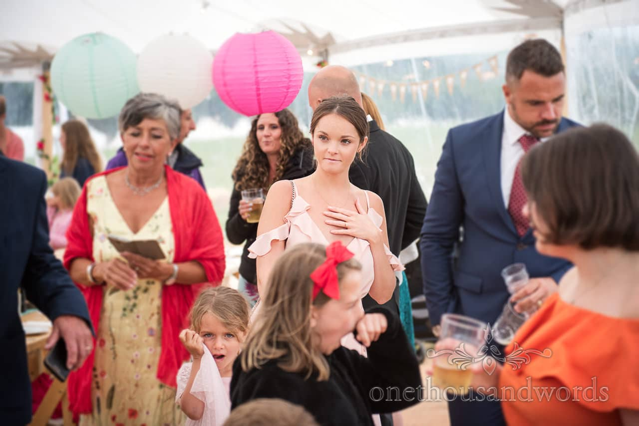Purbeck Valley Farm Wedding Photographs of guests during marquee reception