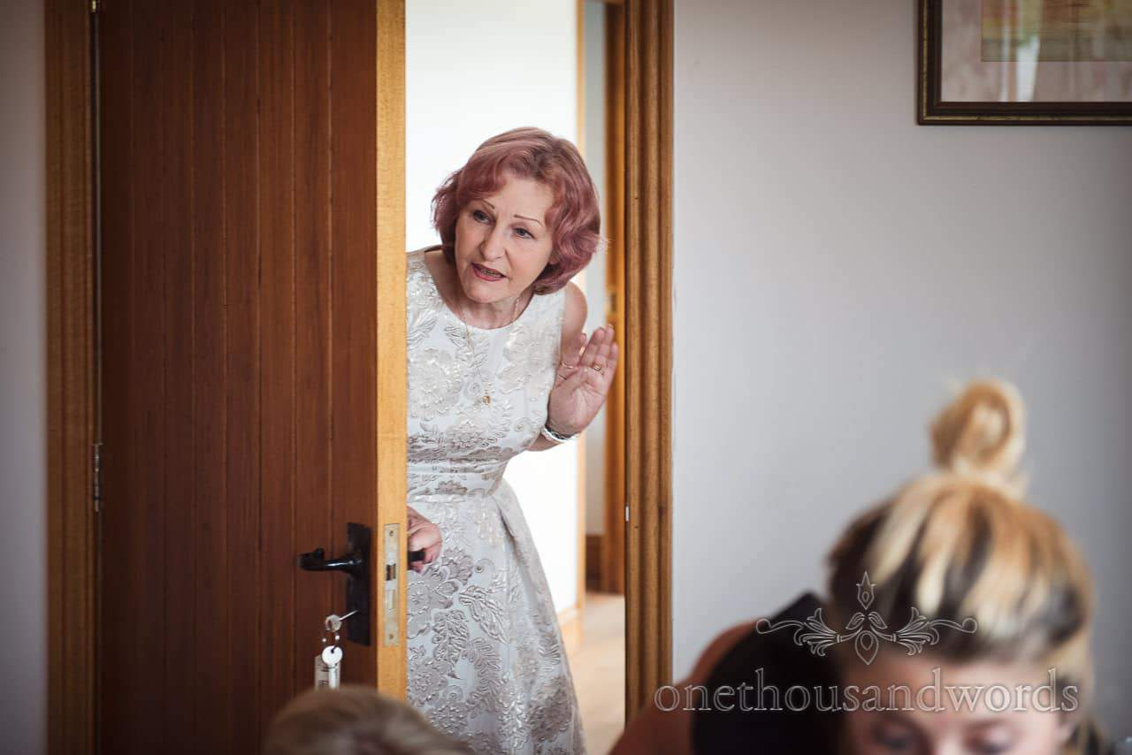 Purbeck Valley Farm Wedding Photographs of guests in doorway during preparation