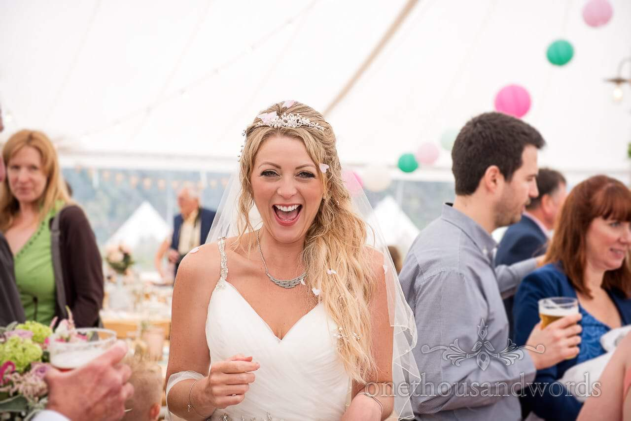 Purbeck Valley Farm Wedding Photographs of laughing bride during marquee reception