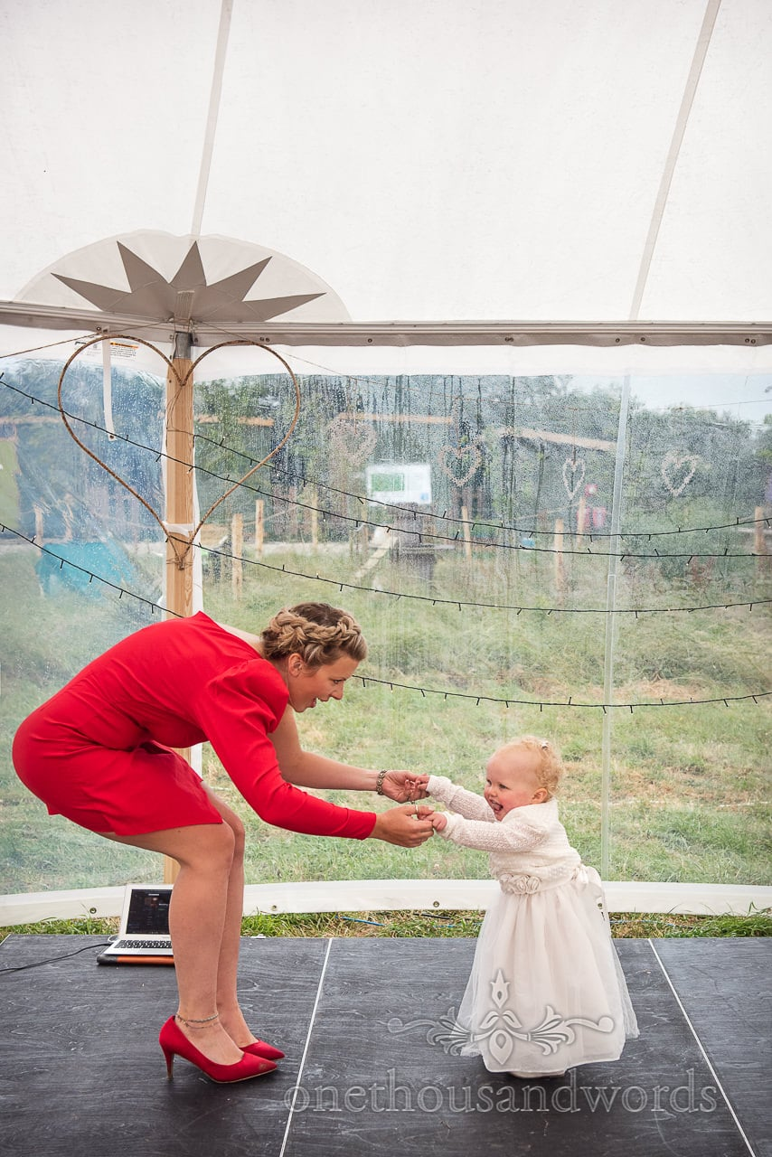 Purbeck Valley Farm Wedding Photographs of mother dancing with baby daughter