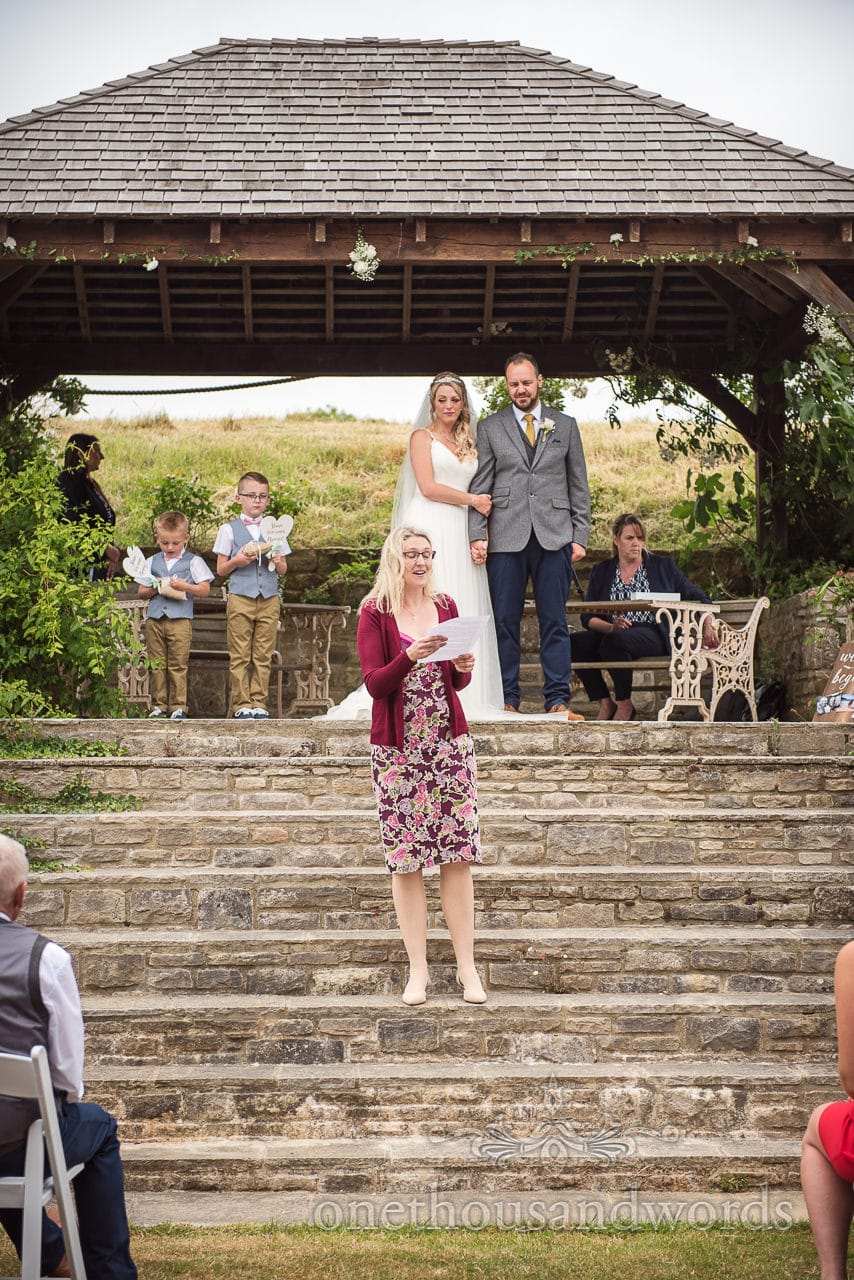 Purbeck Valley Farm Wedding Photographs of reading during outdoor ceremony