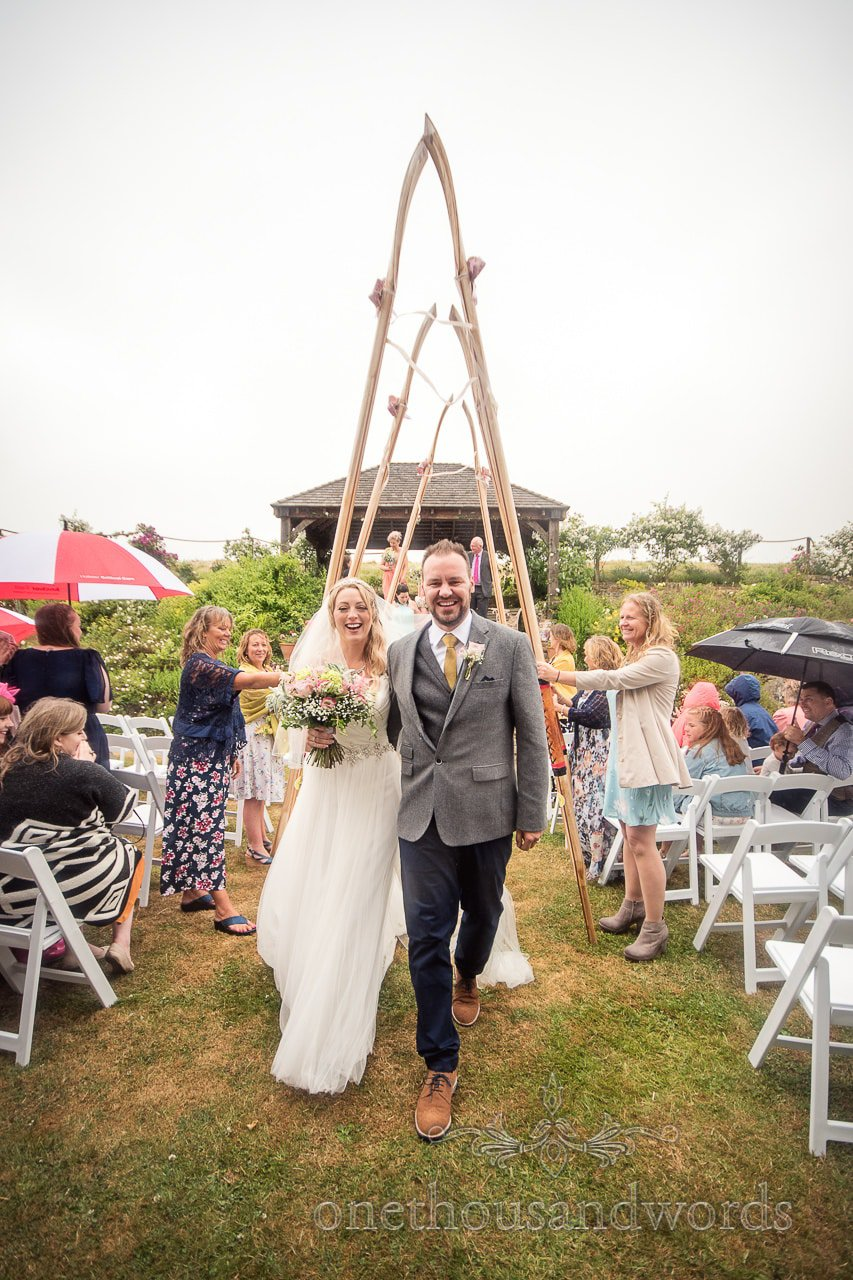 Purbeck Valley Farm Wedding Photographs of rowing oar guard of honor