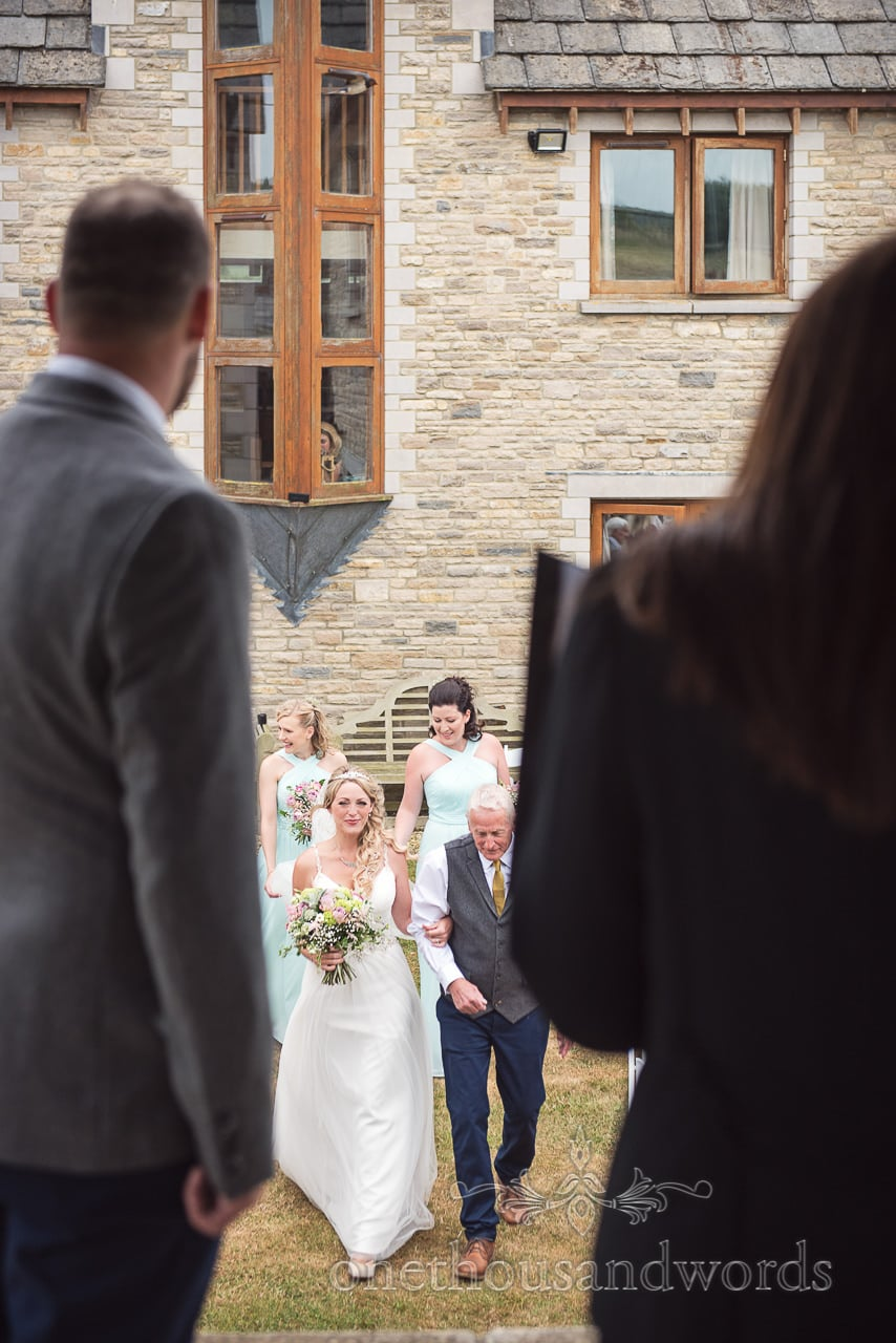 Purbeck Valley Farm Wedding Photographs of the bride coming down the aisle