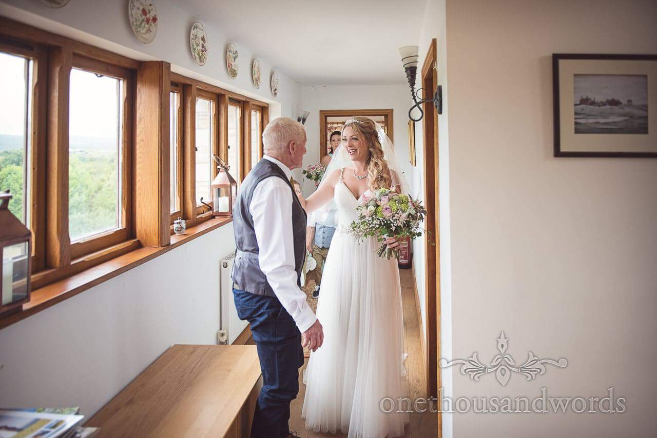 Purbeck Valley Farm Wedding Photographs of the moment father of the bride sees his daughter