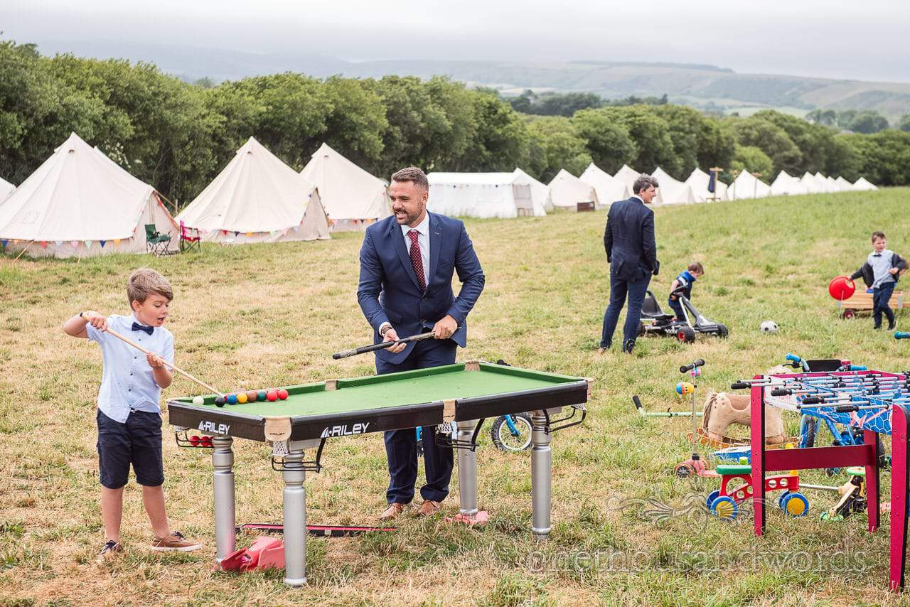 Purbeck Valley Farm Wedding Photographs of young and older guest enjoying games