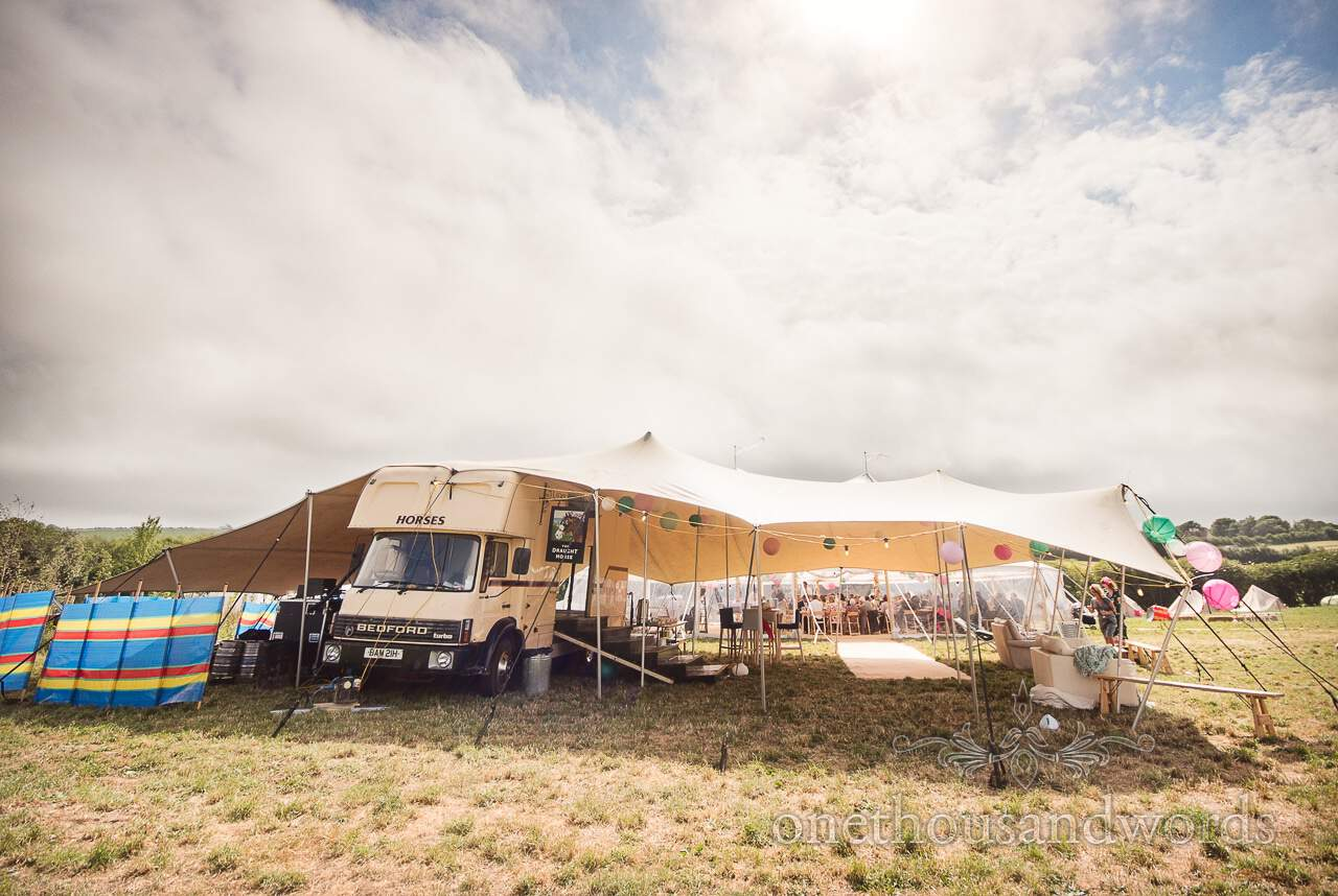 Purbeck Valley Farm Wedding Photographs of Boxpub mobile bar with stretch tent