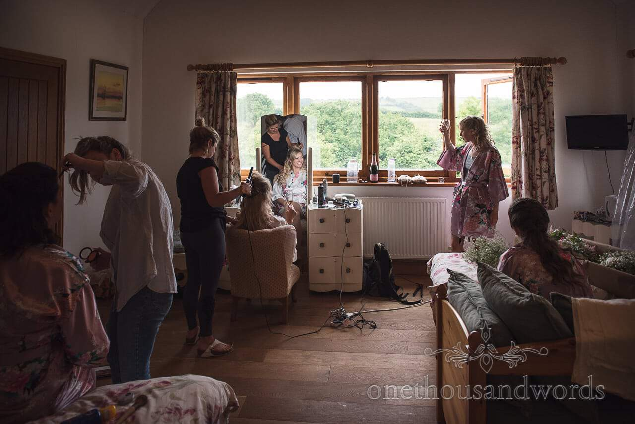 Purbeck Valley Farm Wedding Photographs of bride and bridesmaids morning preparation