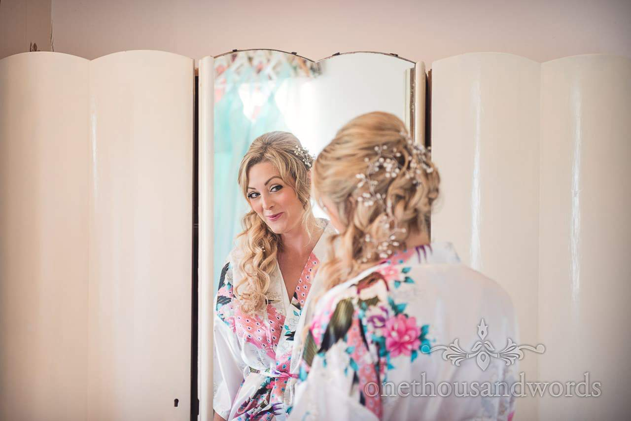 Purbeck Valley Farm Wedding Photographs of bride in mirror from morning preparations