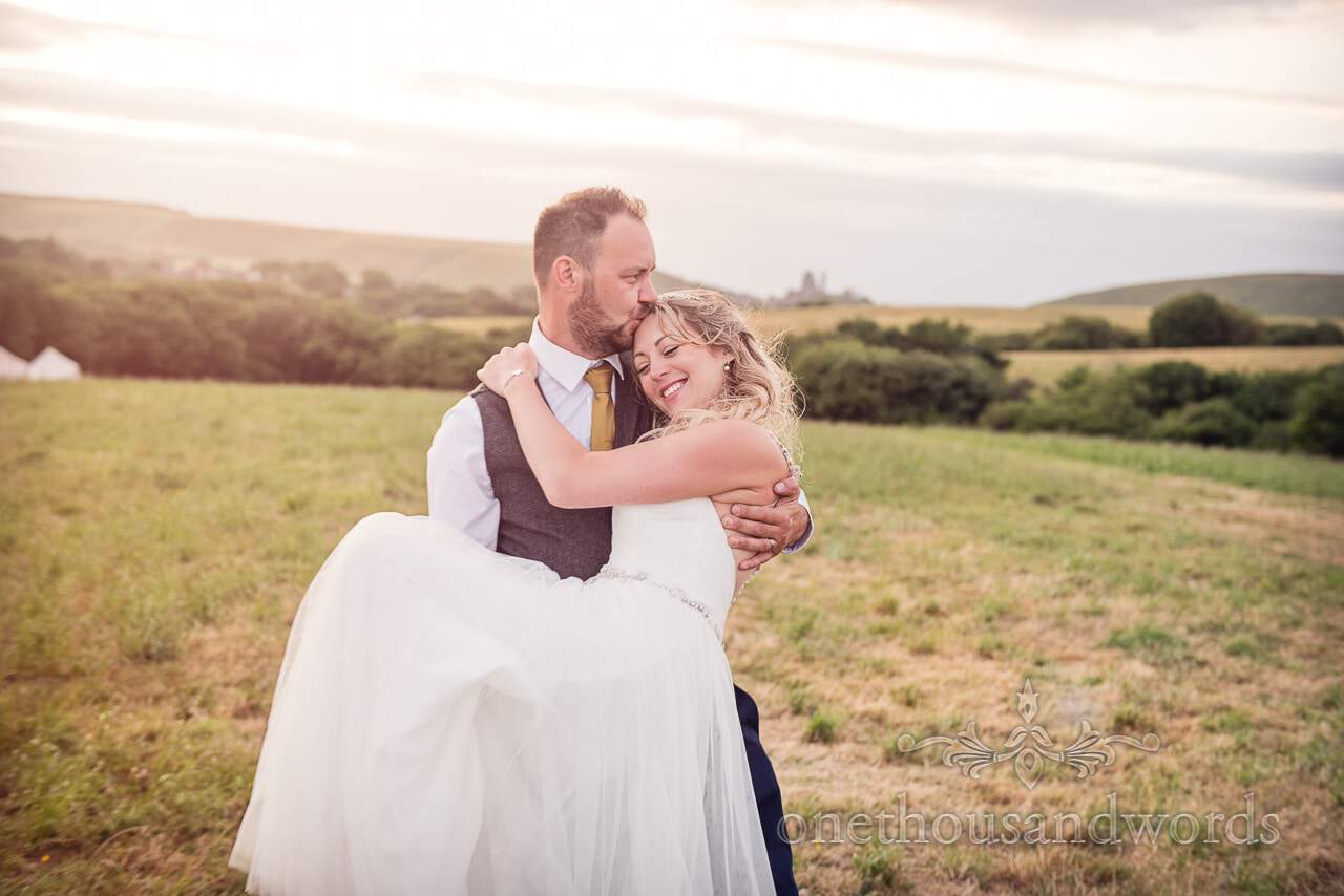 Purbeck Valley Farm Wedding Photographs of groom carrying bride