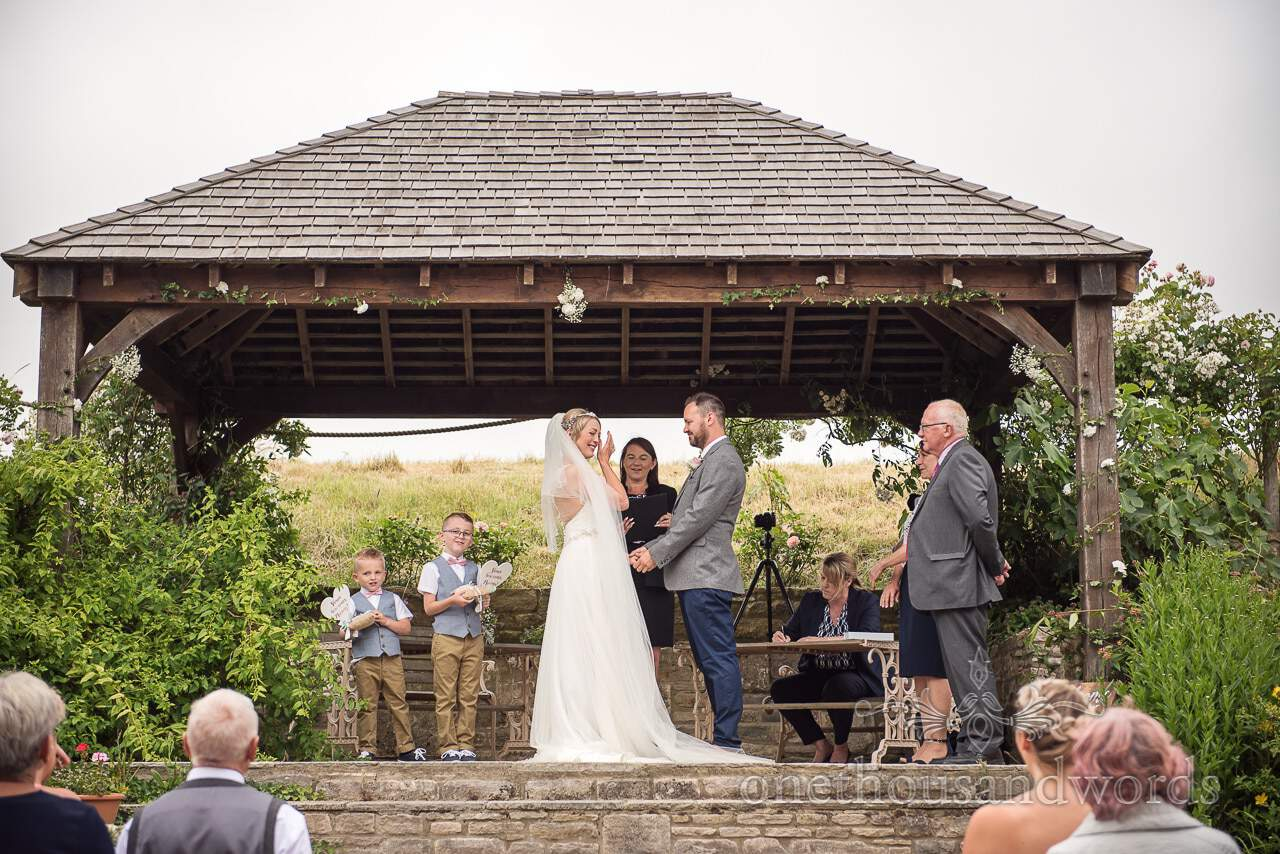 Purbeck Valley Farm Wedding Photographs of outdoor ceremony under pagoda