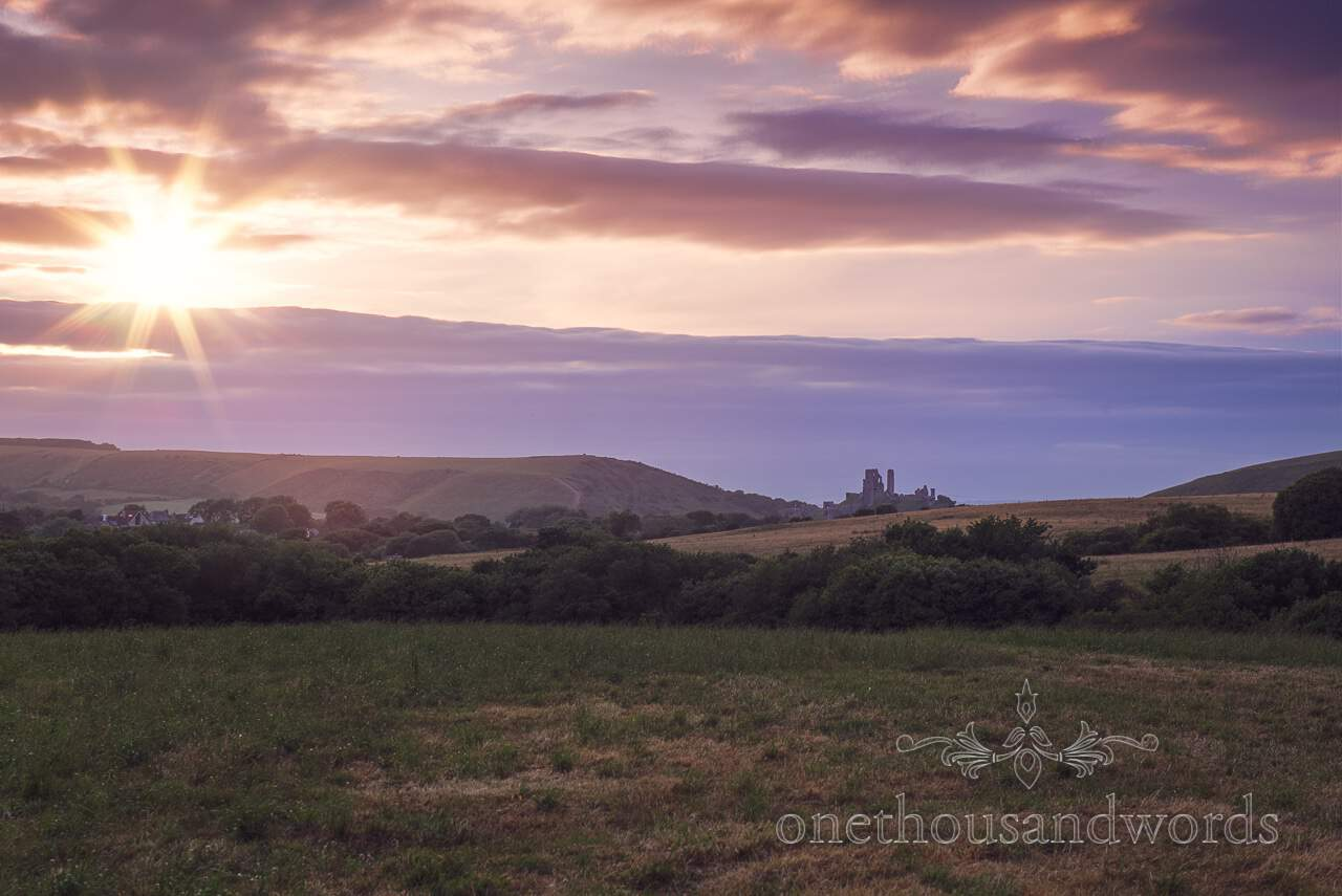 Purbeck Valley Farm Wedding Photographs of sunset towards Corfe castle