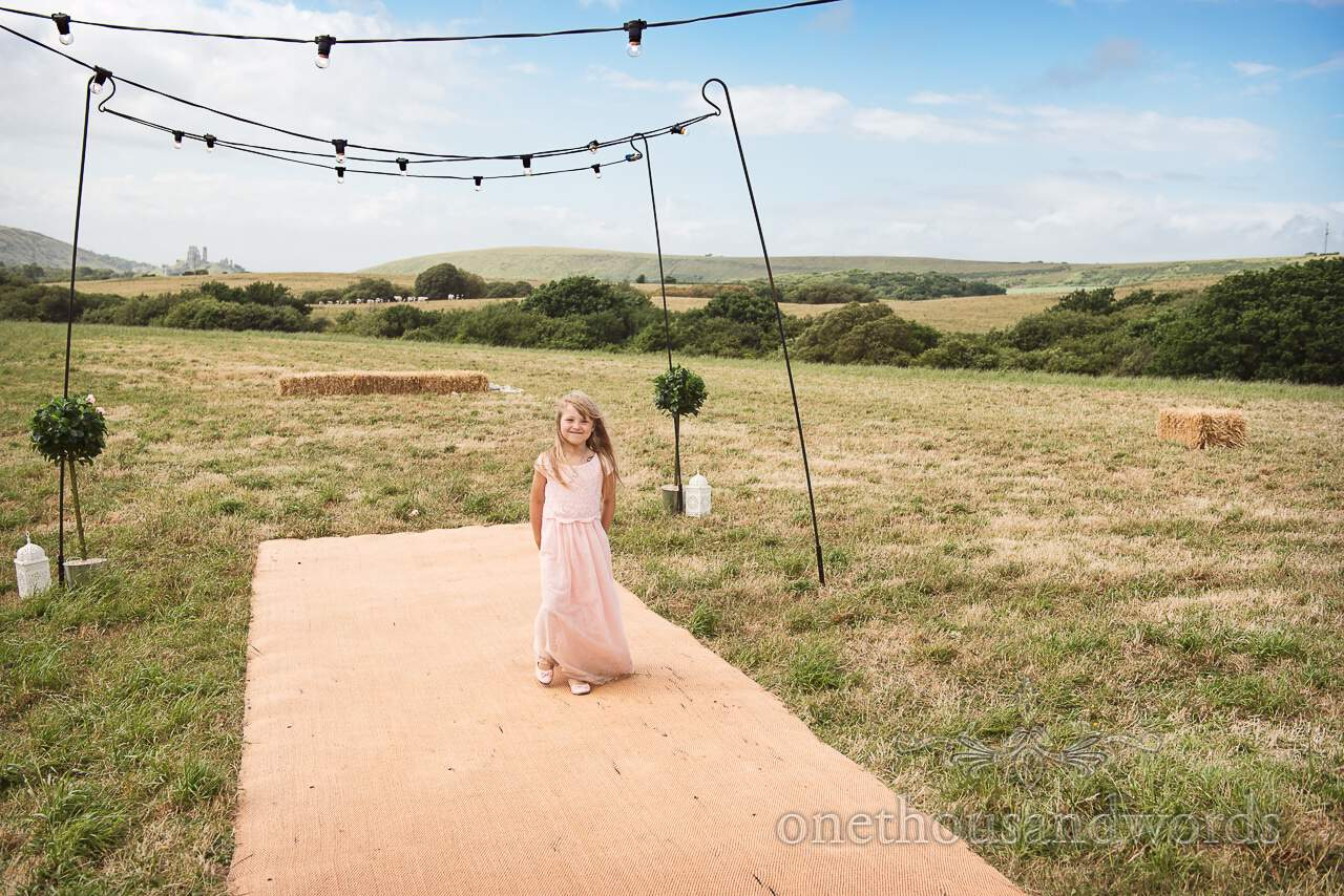 Purbeck Valley Farm Wedding Photographs of young guest during marquee reception