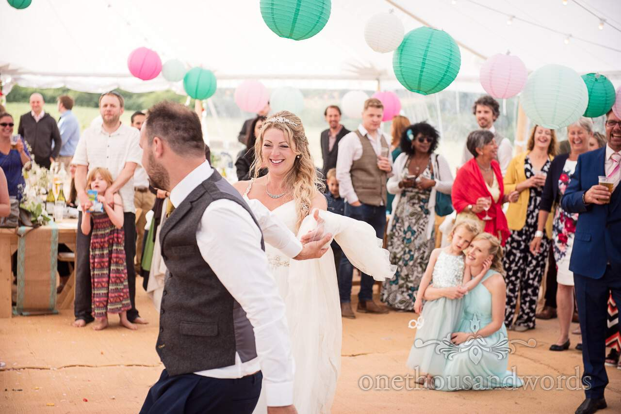 Smiling bride during first dance at Purbeck Valley Farm Wedding Photographs