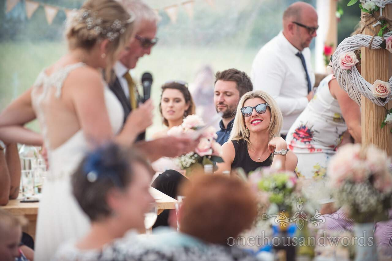 Smiling guest during father of the brides speech at Purbeck Valley Farm Wedding Photographs