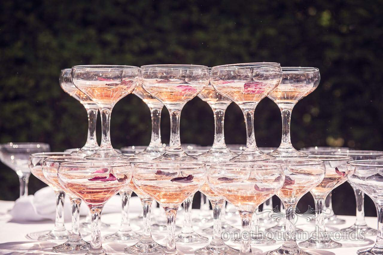 Stacked glasses from drinks reception at Countryside Manor House Wedding