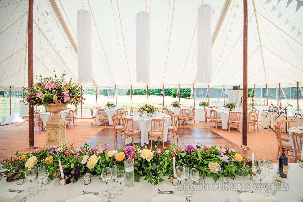 Traditional marquee set for wedding breakfast at Countryside Manor House Wedding
