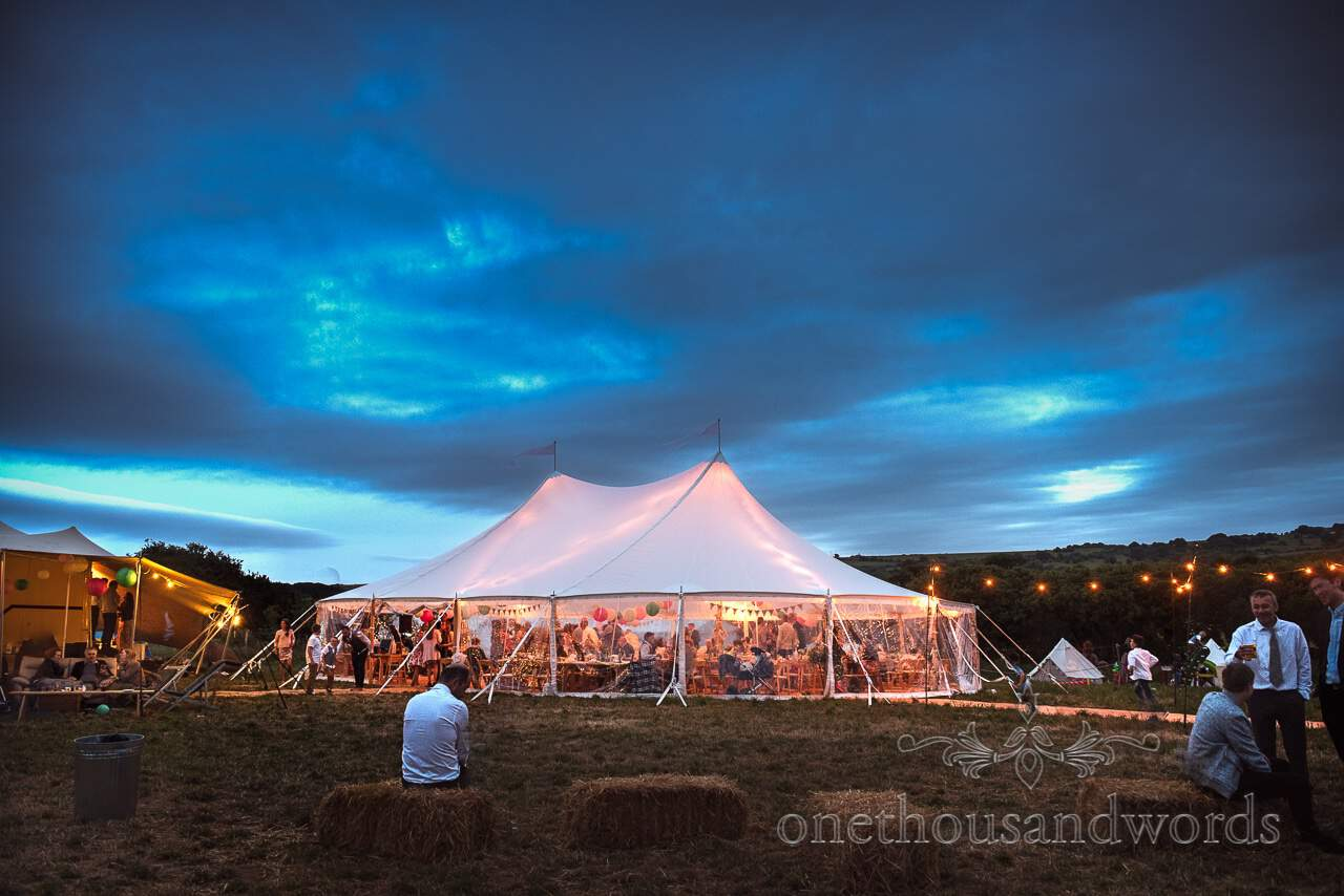 Translucent Sailcloth tent at dusk from Purbeck Valley Farm Wedding Photographs