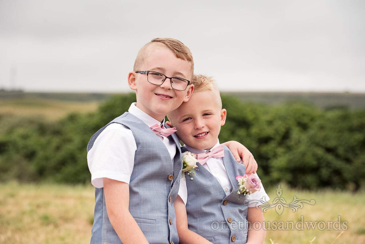 Two brothers in matching waistcoats from Purbeck Valley Farm Wedding Photographs