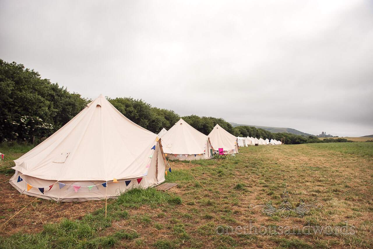 Wedding guest bell tents leading towards Corfe castle from Purbeck Valley Farm Wedding Photographs
