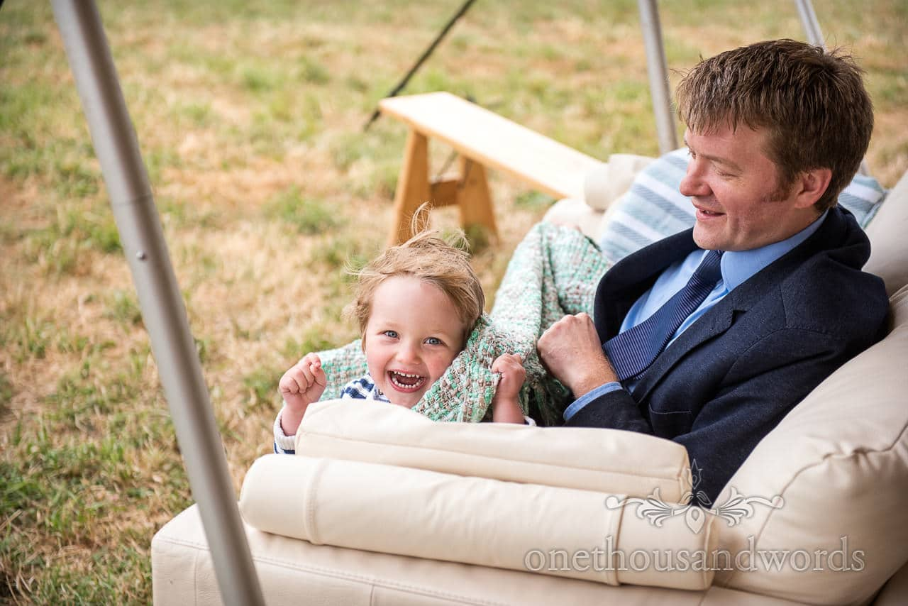 Young guest reacts to photographer from Purbeck Valley Farm Wedding Photographs