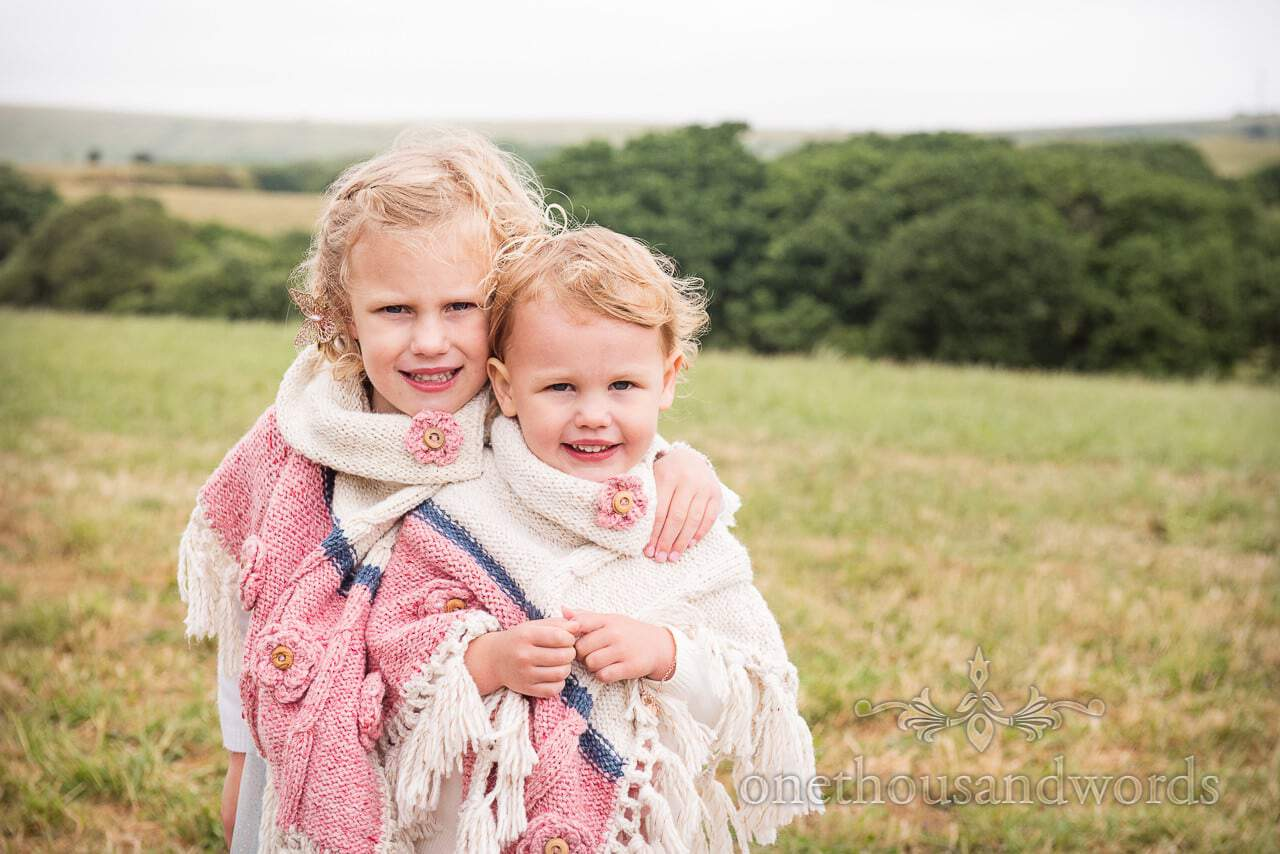 Young wedding guests with matching shawls from Purbeck Valley Farm Wedding Photographs