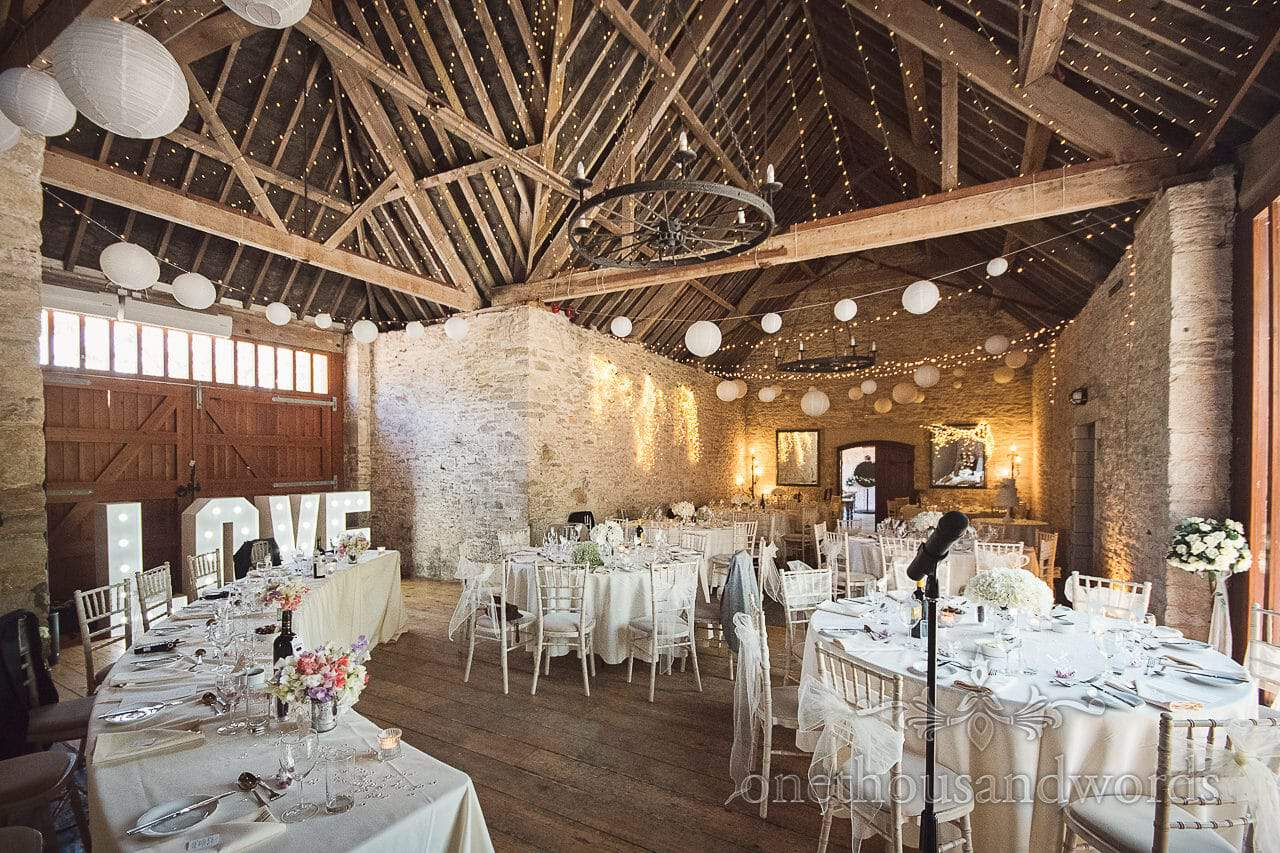 Barn wedding breakfast set up at Kingston Country Courtyard venue in Dorset