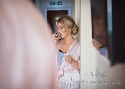 Beautiful blonde bridesmaid laughs during wedding preparations at Sandbanks Hotel
