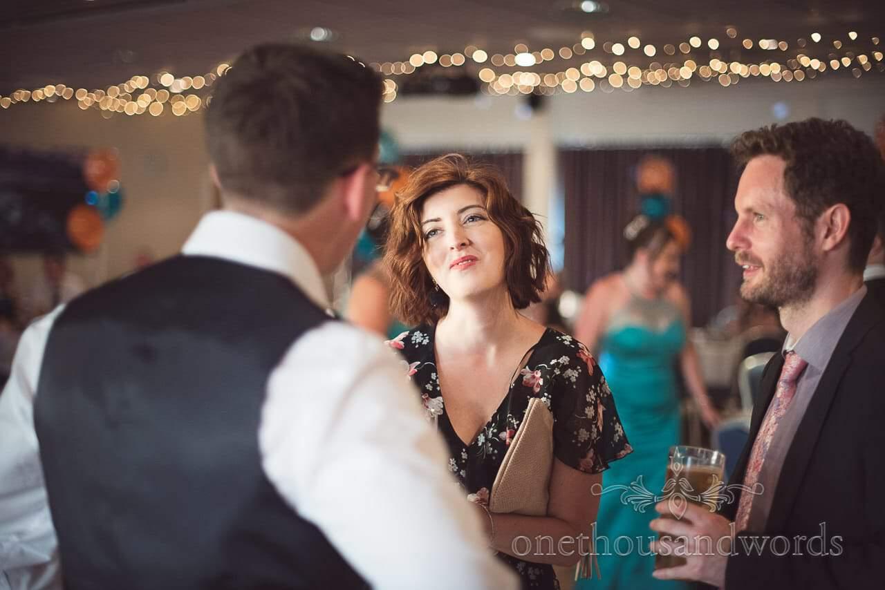 Beautiful wedding guest on dance floor at RLNI College Wedding