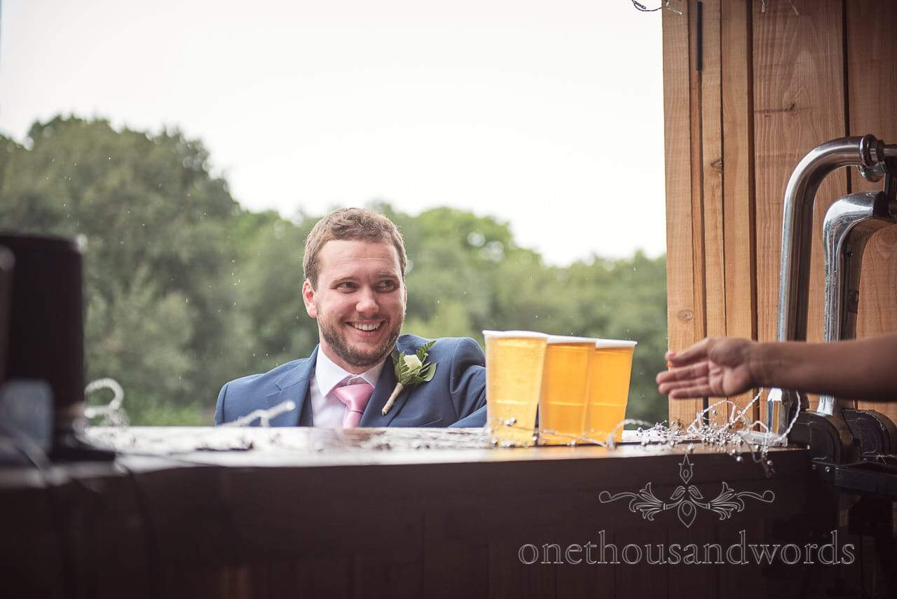 Best man orders wedding beers from A&D mobile bars wooden horsebox bar