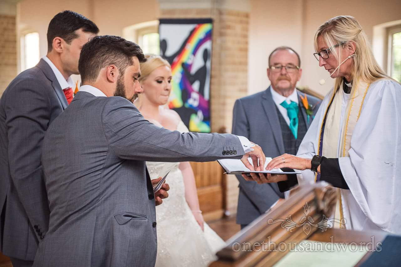 Best man presents the wedding rings at St Michael's church wedding ceremony
