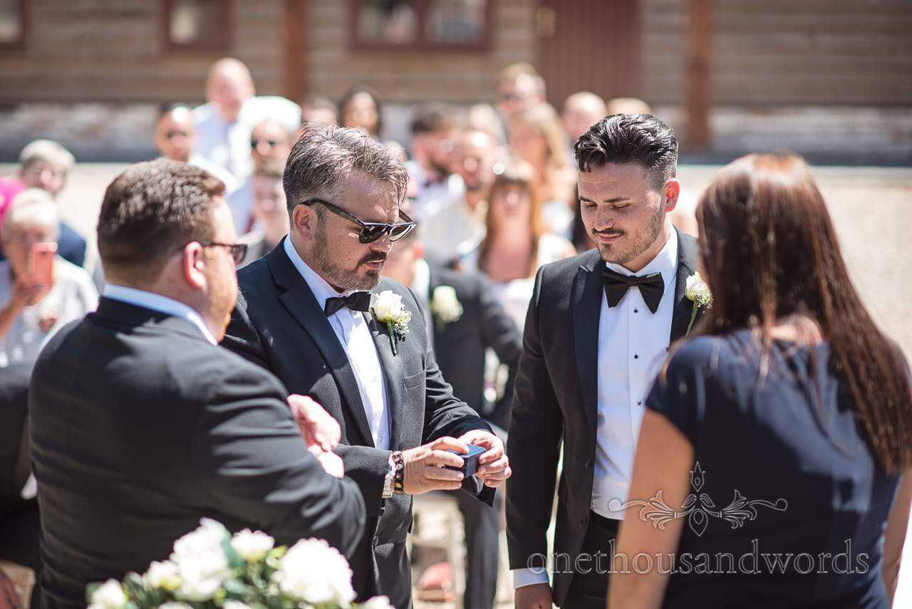 Best man with the rings at outdoor ceremony at Country Courtyard Wedding
