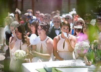 Bevy of bridesmaids during outdoor ceremony at Country Courtyard Wedding