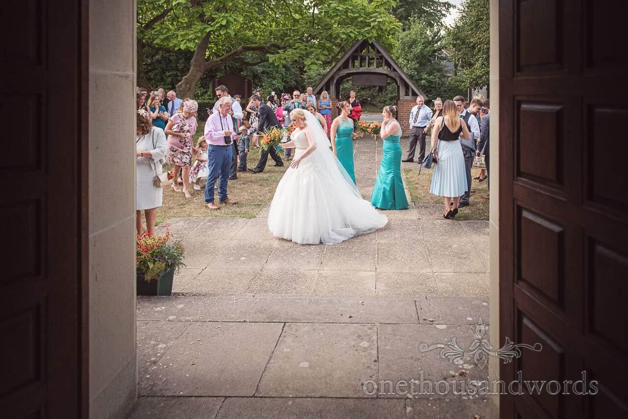 Bride and bridesmaids outside St Michael's church wedding venue in Hamworthy