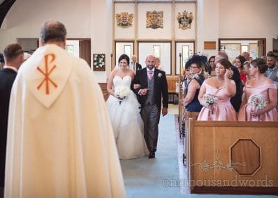 Bride and father walk down the aisle at Sandbanks church Wedding in Poole, Dorset