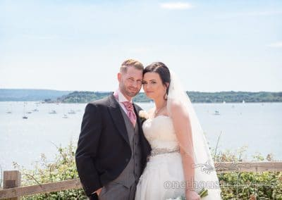Bride and groom at Evening Hill in Poole overlooking Poole Harbour couple photo