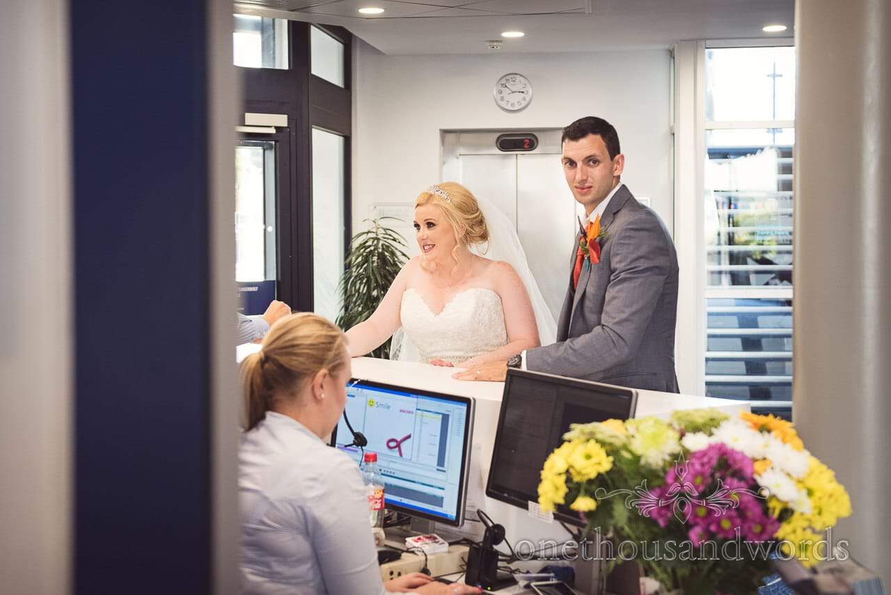 Bride and groom check into hotel at RNLI College Wedding Venue in Poole