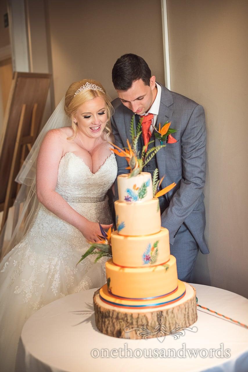 Bride and groom cut wedding cake at RNLI College Wedding evening reception