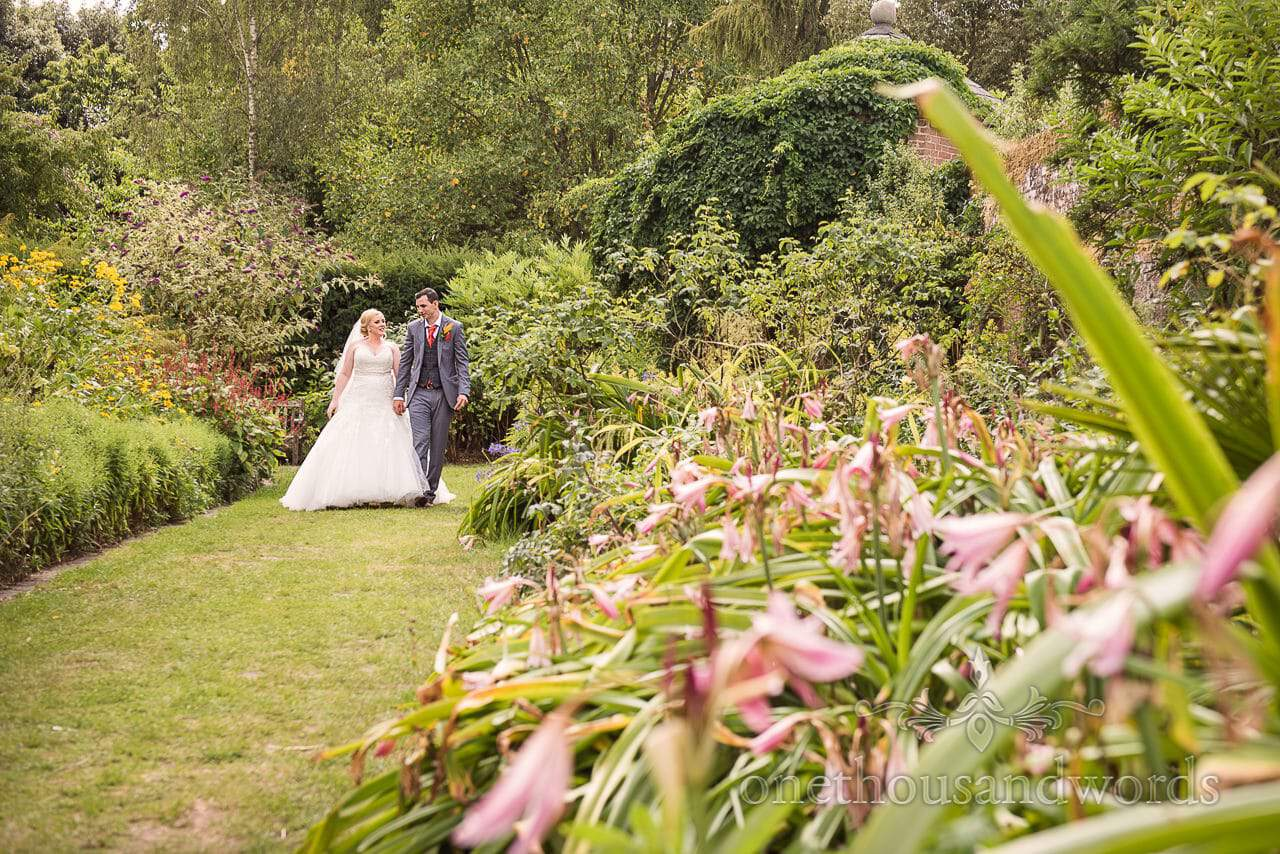 Bride and groom in flower gardens at Upton Country House wedding venue