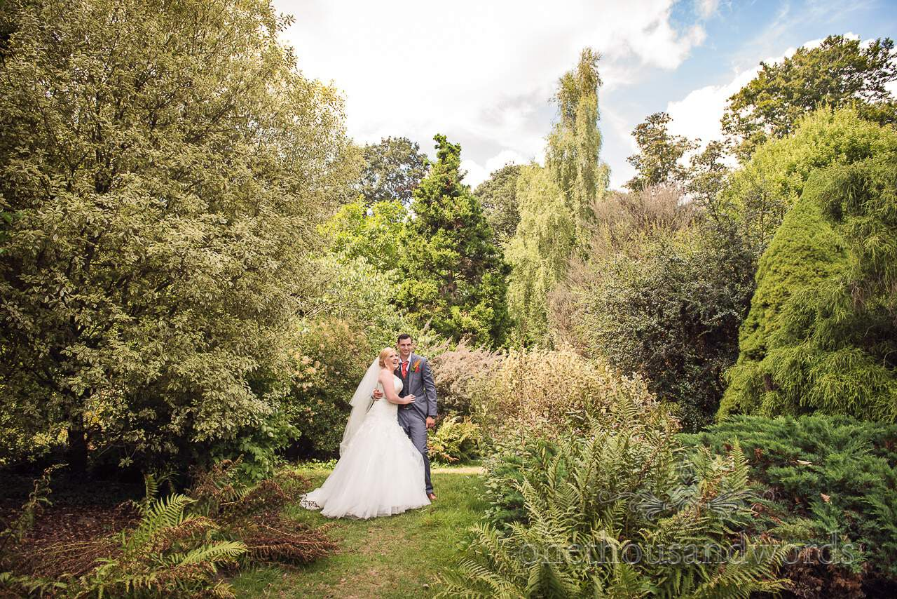 Bride and groom in gardens at Upton Country house in Poole, Dorset