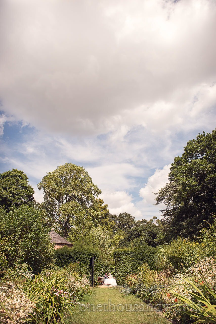Bride and groom in gardens at Upton Country House wedding venue in Dorset