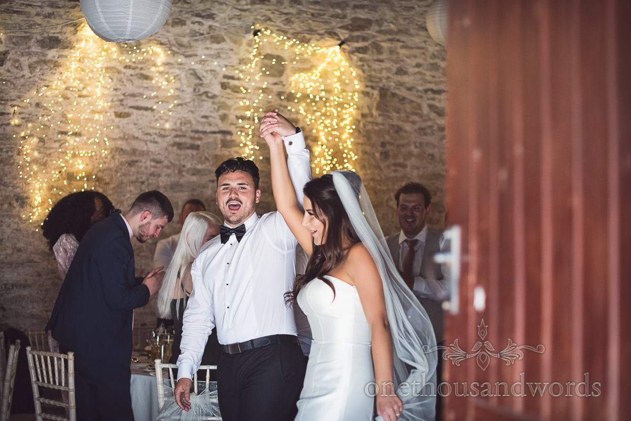 Bride and groom make an entrance at Country Courtyard Wedding