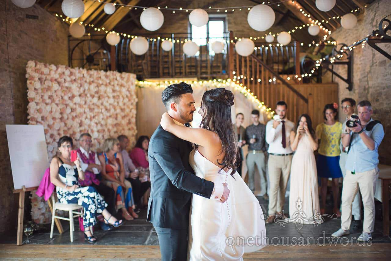 Bride and groom perform their first dance at Country Courtyard Wedding